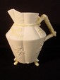 Belleek three footed Cherry Blossom decorated pitcher, early mark 7
