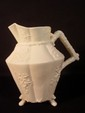 Belleek three footed Cherry Blossom decorated pitcher, first black mark 7