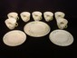 13 pcs. Belleek Shamrock basket weave plates and cups, largest plate 8.5