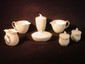 Seven pcs. Belleek table wares: spiral shell creamers and covered boxes w/ gold mark, double spouted creamer w/ green mark, etc.
