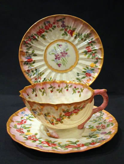 Neptune Cup and Saucer, highly decorated.